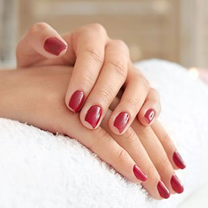 Gel Manicure - Close up of recently manicured hands with gel nail polish.